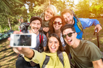 Cheerful girls and boys makes selfie