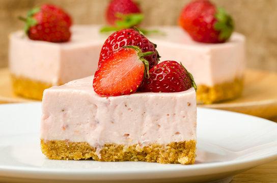 Homemade strawberry cheesecake  on white plate