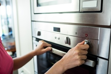 Woman setting up the oven