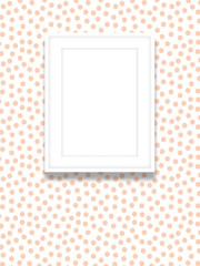 Close-up of one white blank picture frame on pink dots background