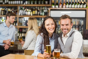 Couples holding beer