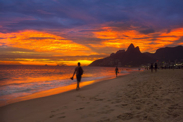 Sunset view of Ipanema beach and mountain Dois Irmao (Two Brother) in Rio de Janeiro, Brazil