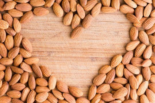 Heart shaped frame of fresh raw almonds