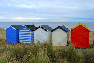 Colorful beach huts in British seaside