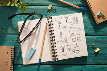 business concept - notepad with sketch on the desk