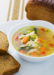 Vegetable soup with chicken breast in bowl