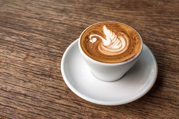 hot coffee with latte art in swan shape