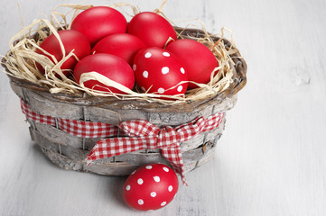 Red Easter eggs in basket