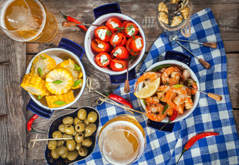 Selection of spanish tapas  and beer