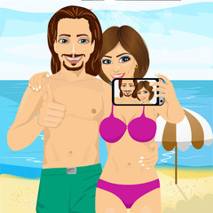 young couple taking selfie photo together using smartphone camera at the beach and showing thumbs up