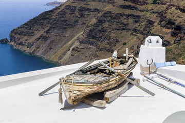 Beautiful landscape with sea view and boat in Santorini, Greece