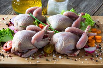 Raw quails, onions, garlic, lettuce, olive oil, carrot...