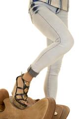 woman foot on saddle denim jeans