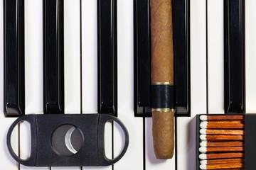 Piano keyboard and luxury cigar
