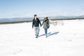 Couple In winter Snow Scene at beautiful sunny day