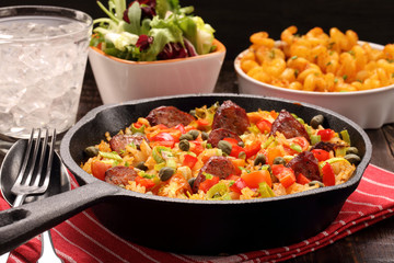 Rice with chorizo sausage and vegetables baked in a pan
