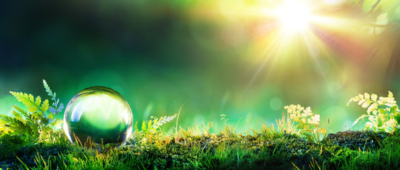 Crystal Green Globe On Moss - Environmental Concept