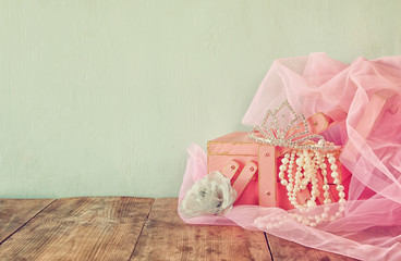 Wedding vintage crown of bride, pearls and pink veil. wedding concept. selective focus. vintage filtered