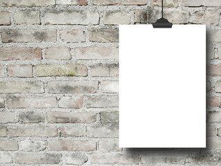 Close-up of one hanged blank frame with clip against grey weathered brick wall background