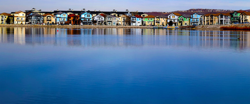 The blue lake of Sparks Marina against the backdrop of colorful houses.