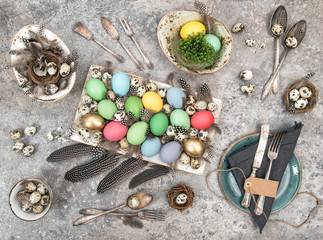 Festive table place setting decoration with easter eggs