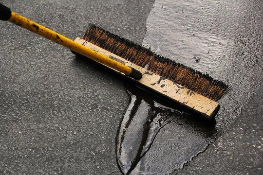 Sealing a damaged asphalt drive way