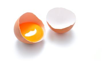 Close up of cracked egg isolated on white background