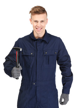 A young repairman holding a hammer, on white background
