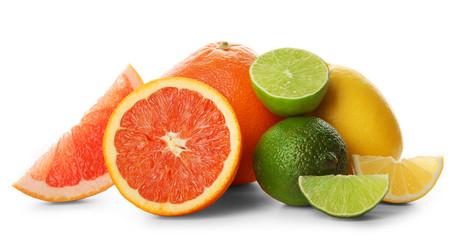 Fototapete - Mixed citrus fruit including lemons, grapefruits, orange and limes isolated on a white background, close up