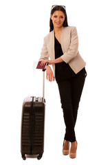 Woman with suitcase and travel documents going on a business tri