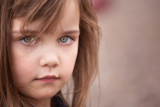 portrait of a little girl with big sad eyes