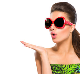 Fashion model girl wearing red sunglasses showing empty copyspace on open hand