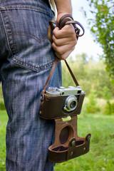 retro camera in hand men