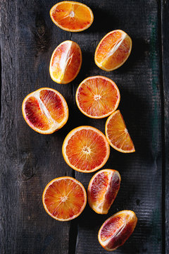 Overhead view of blood orange fruit on wooden table