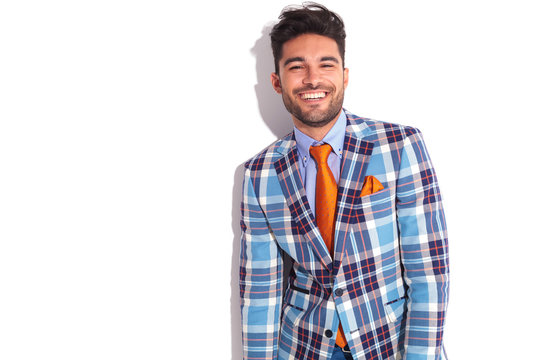 casual man in plaid jacket and orange tie