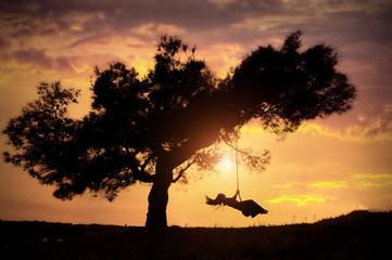 woman silhouette on swing