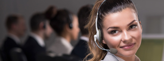 Pretty woman working in call center office