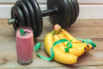 smoothies and a bunch of bananas, a dumbbell in the background