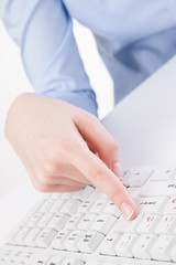 young woman typing on a keyboard