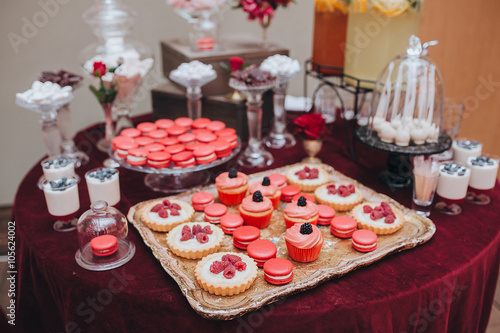 Wedding Candy Bar Buffet On The Table With A Tablecloth Color