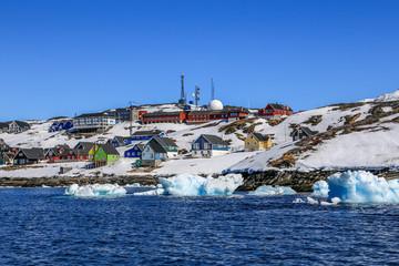 Drifting icebergs along Nuuk city, Inuit capital Nuuk, Greenland
