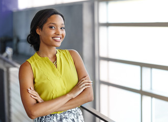 Portrait of a confident black businesswoman at work in her glass office Wall mural