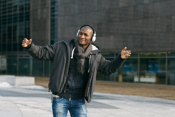 Black Man Dancing and Listening to Music in the Street