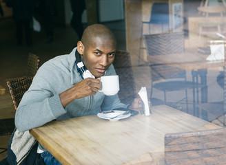 Portrait of a Black Man Having a Hot Coffee