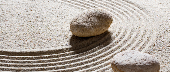 Photo sur Plexiglas Zen pierres a sable zen sand still-life - textured stones set on sinuous waves for concept of steadiness or suppleness with inner peace
