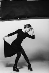 Charismatic woman,dramatic poses, black and white photo, studio