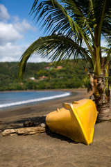 Yellow boat laying on Playa Del Coco.