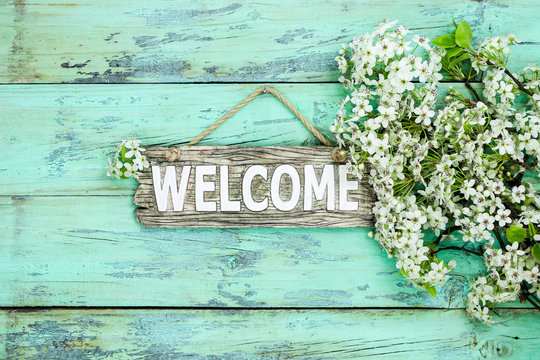 Welcome sign with spring tree blossoms