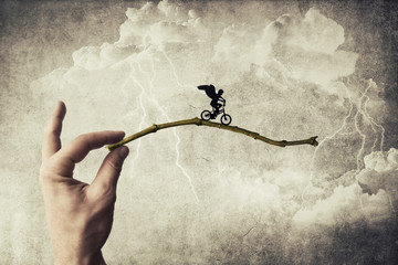 Boy riding a bicycle try to jump over a chasm. Self overcoming and risk taking concept Wall mural