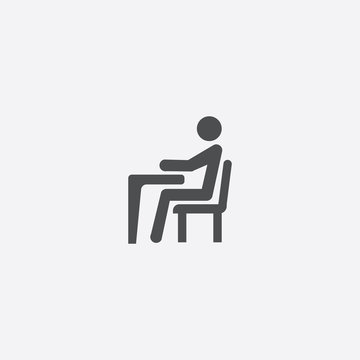 man sitting at the desk icon